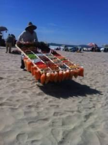 A man selling candy at Rosarito Beach