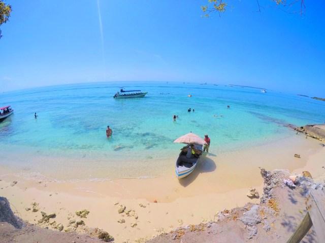 lobster boat in water on isla grande