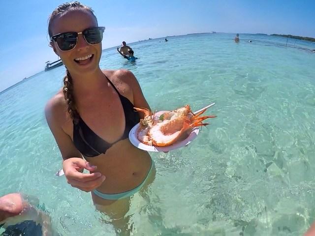 eating lobster in ocean on isla grande
