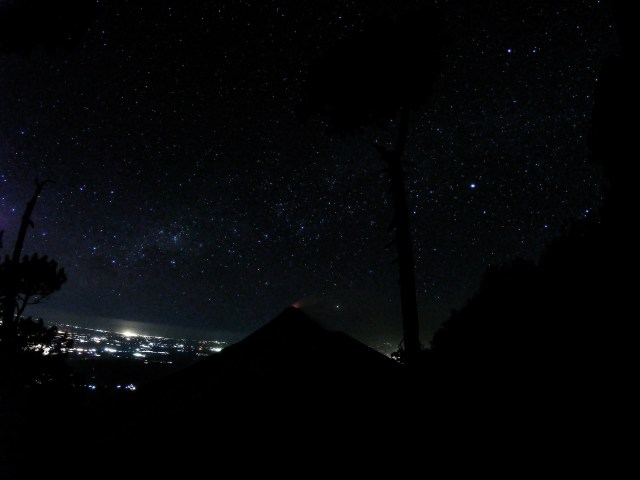 Stars above Fuego erupting at night from Acatenango
