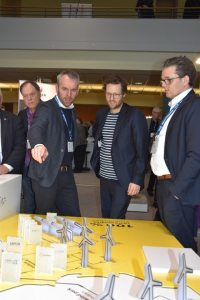 """This is how we imagine the future,"" explained GP Joule CEO O. Petersen to Energy Turnaround Minister J. P. Albrecht (centre); right: Exhibition boss A. Petersen"