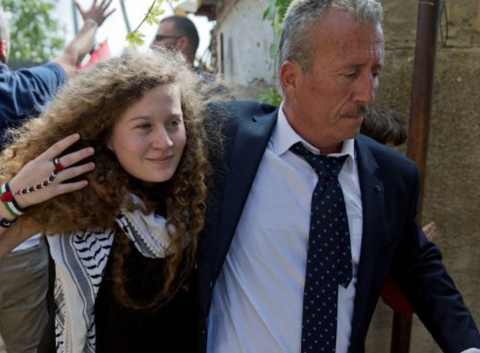 Ahed Tamimi walks with with her father Bassem upon her arrival at their West Bank home village of Nebi Saleh, near Ramallah, July 29, 2018.