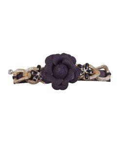 Patentspange mit aufgesetzter Rosenblüte aus Stop, Kettengliedern und schwarzen Blüten mit Strass schwarz