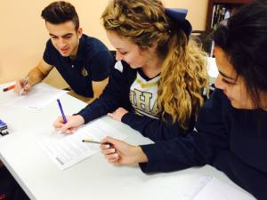 Scholars working together on a group project