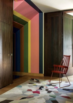 Playful colour stripes inspired by Ndebele art complement the rug and Patricia Urquila chair.