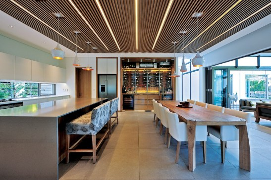 Free-flowing interiors encapsulate a generous kitchen / dining area.