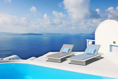 Swimming pool overlooking the caldera in Oia, Santorini, Cyclades, Greece