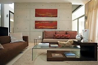 Both the sofa and the bench were custom designed as was the coffee table. The Barcelona chair adds contemporary panache.