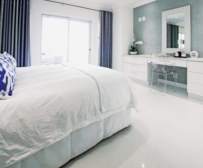The white-on-white theme continues in the bedroom and bathroom augmented by plentiful natural light.