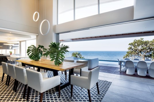 Glass balustrades are utilised throughout, enhancing transparency and minimising the impact on the ocean views.