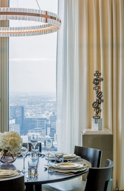 Artwork throughout the apartment makes reference to cubist and modernist influences, such as the bronze Rising Structure by Antonio López Reche, located in the dining area and displayed on a plinth.