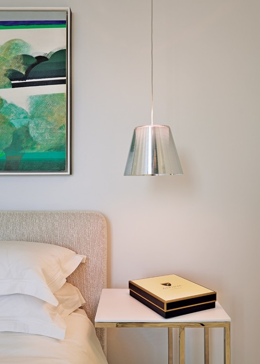 Bedside pendants in the guest bedroom are by FLOS.