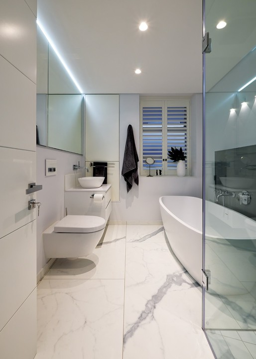 Fittings in the bathroom are by Flush and are in synergy with the Studio Masson floor.
