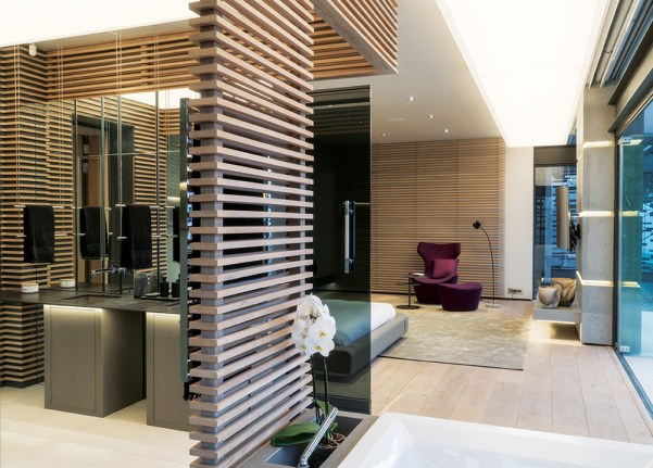 The main ensuite can be concealed by sliding smoked glass screens.
