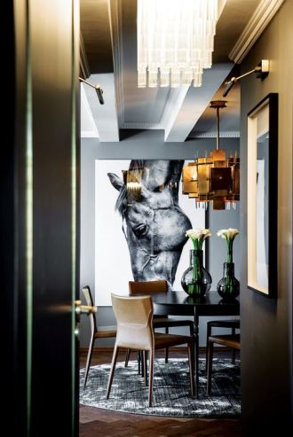 Contemporary furniture is a foil for ornate cornices and ceilings and contemporary lighting fixtures are mixed with crystal chandeliers and classic artwork luminaires.