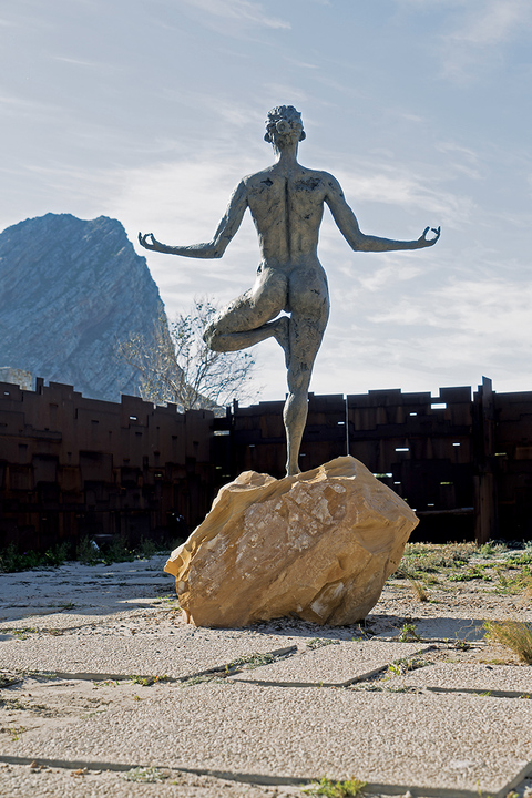 'Sanyata' statue (yoga woman) by Robin Kutinyu (right).