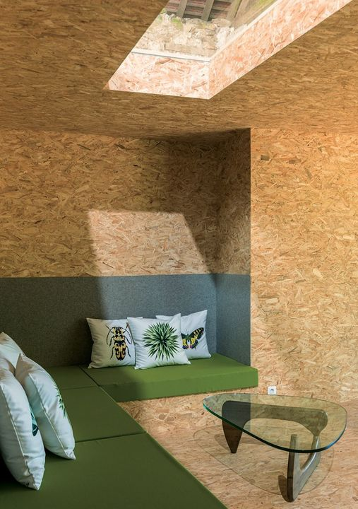 Felt is used as headboard cladding in the bedrooms and around the built-in sofa. The OSB was sourced from a local mill.