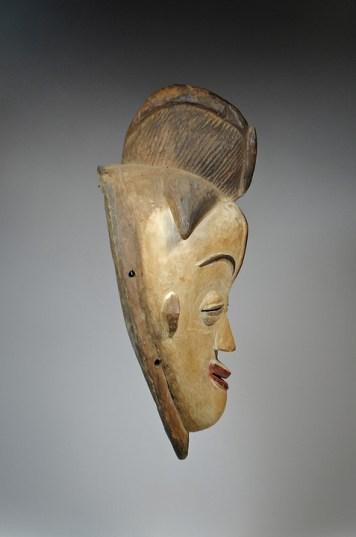 David Malik Punu mask 'Okuyi' Gabon Wood Early - mid 20th Century £1,800 Provenance: - Robert Dreyling, Aachen, Germany - Gunter Beuth, Cologne, Germany - Gerhard & Gisela Hoffmann, Wurzburg, Germany