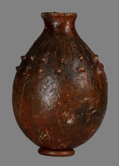 "Marcuson & Hall A Saqa-ni-wai earthenware vessel Fiji, Melanesia earthenware with resin glazing 19th Century 3.5 cm high x 22.5 cm diameter Good but used condition; two nodules missing, minor scratches and glaze loss Fijian earthenware pottery is an ancient craft dating back to the original settlers, the Lapita culture of 1000-900 BC. Pots were made by the women of the coastal, sea-faring clans and are constructed with slabs of clay, which are assembled and paddled into shape using a technique known as ""paddle and anvil"". The finished vessels are glazed with a resin from the Dakua tree which is poured on the pots while they are still hot from the firing. Dakua is the local name for a genus of the Agathis, an ancient evergreen conifer that dates back to the Jurassic period. In New Zealand it is known as the Kauri"