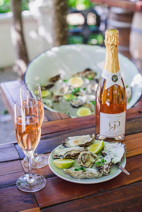 Grande Provence MCC and Oyster tasting portrait with bottle in focus LR