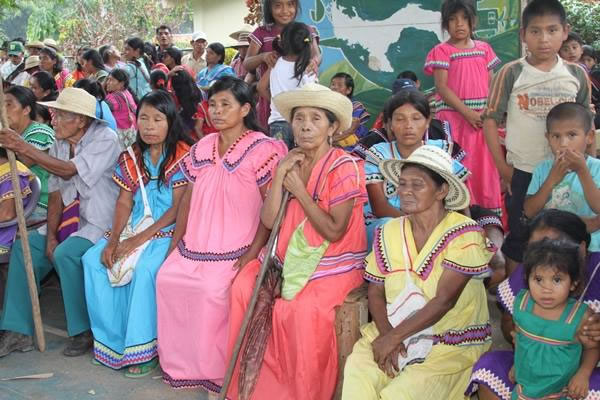Group of indigenous waiting in line to receive handouts from the goverment