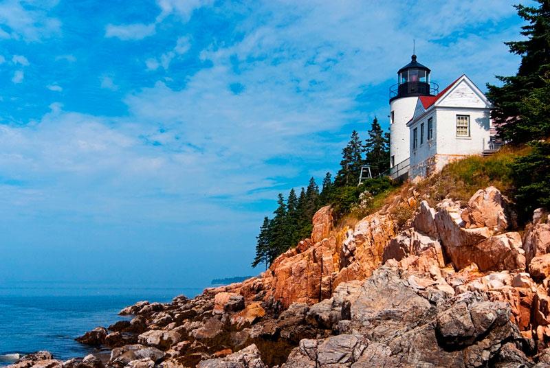 Bass Harbor Lighthouse on the rocky coast on a sunny day