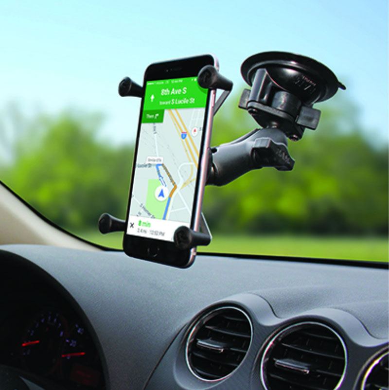 phone in a suction-cup mount connected to a car windshield
