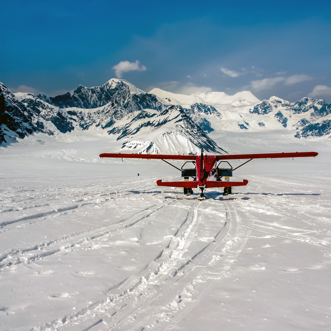 red airplane on Ruth Glacier