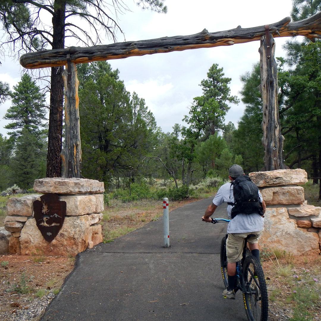 man biking on the Tusayan Greenway in Grand Canyon National Park