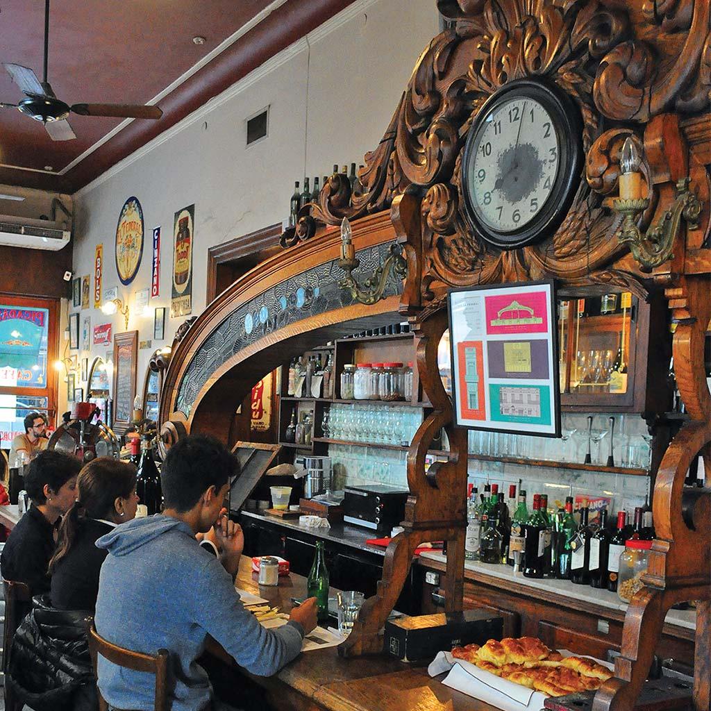 The elegant and decorative wooden bar at El Federal.