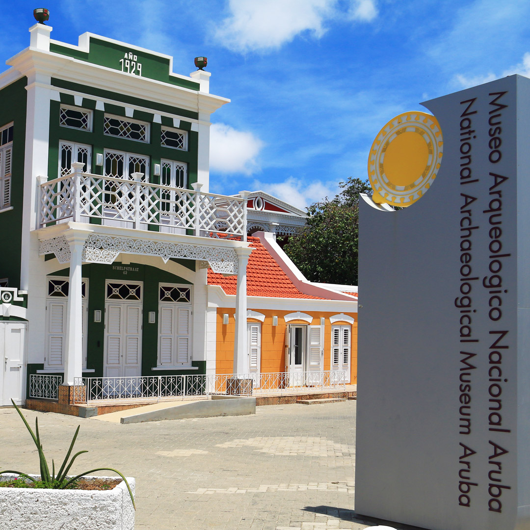 sign and front of building of the National Archaeological Museum Aruba