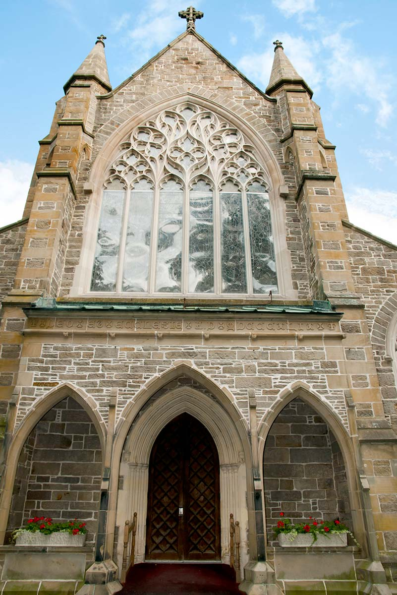 Exterior view of magnificent stained glass windows at Fredericton's Christ Church Cathedral.