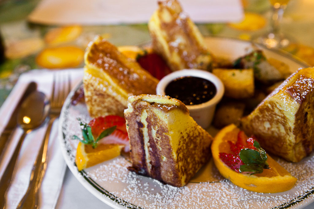 A beautifully arranged plate of french toast.