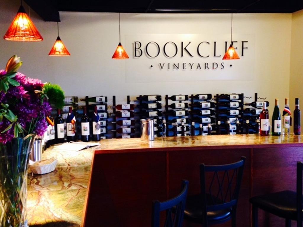 stacks of wine bottles in a tasting room