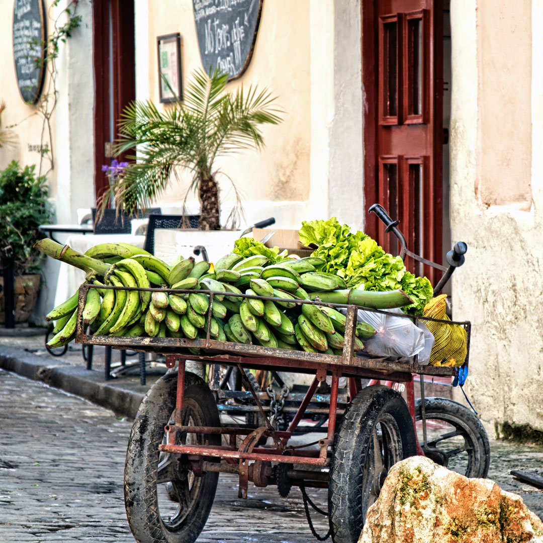 a fruit cart loaded with bananas in Havana