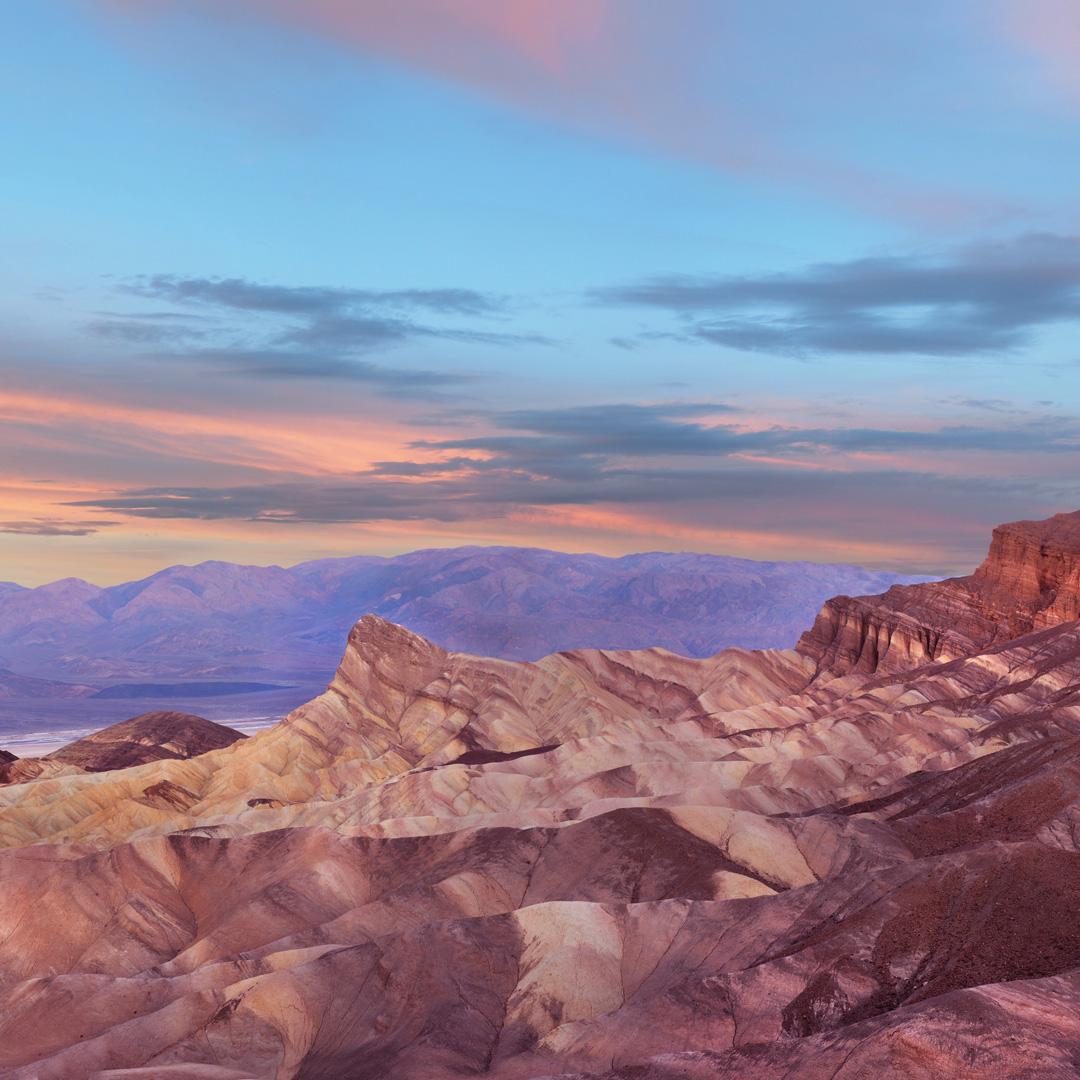 sunrise over zabriskie point in death valley national park