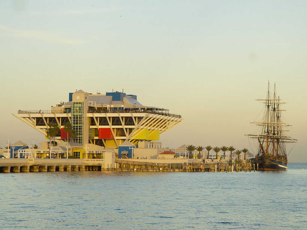 the St. Petersburg pier and a large boat at sunset