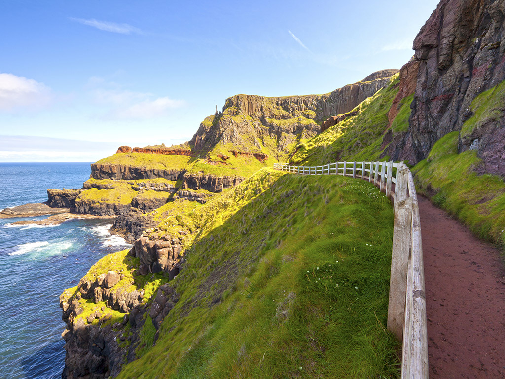 footpath winding along the coast of the ocean in Ireland near Giant's Causeway