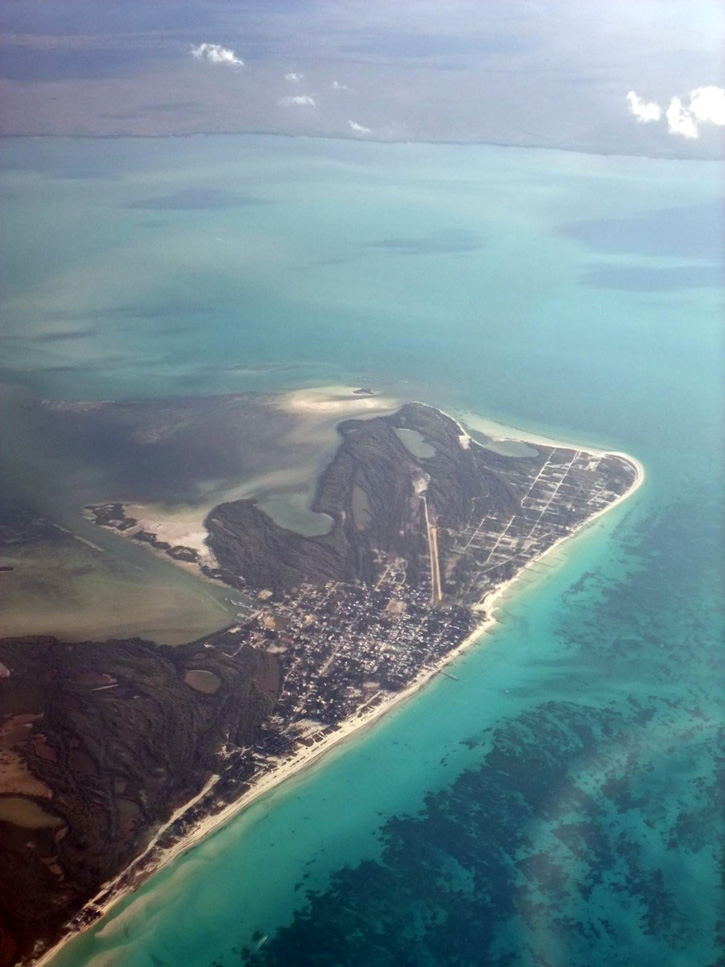 Aerial view of Isla Holbox's miles of beach, with the mainland of the Yucatán Peninsula in the distance.