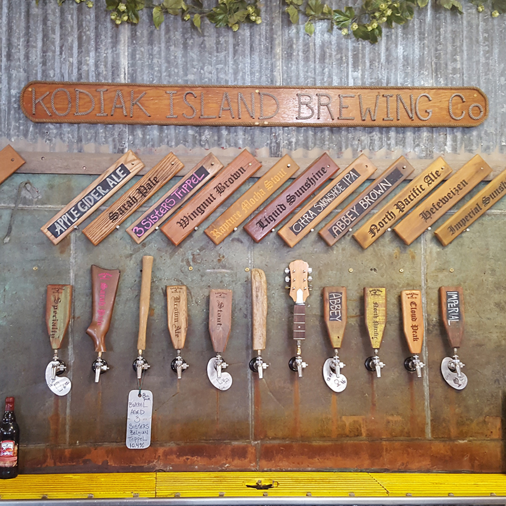 Line of taps at Kodiak Brewing Company, set in wooden plank and rope