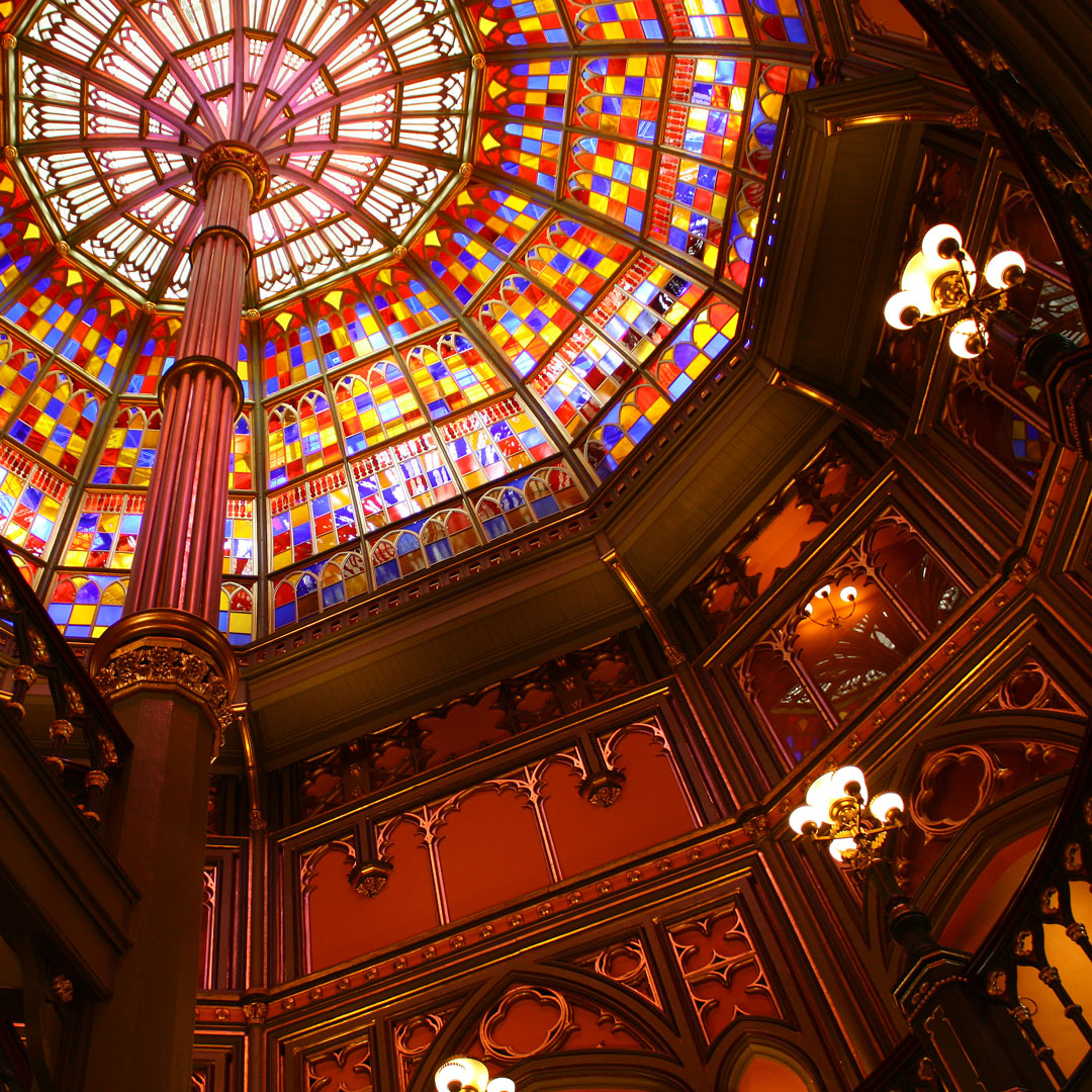 light shines through a stained glass ceiling inside the old state capitol building in Baton Rouge