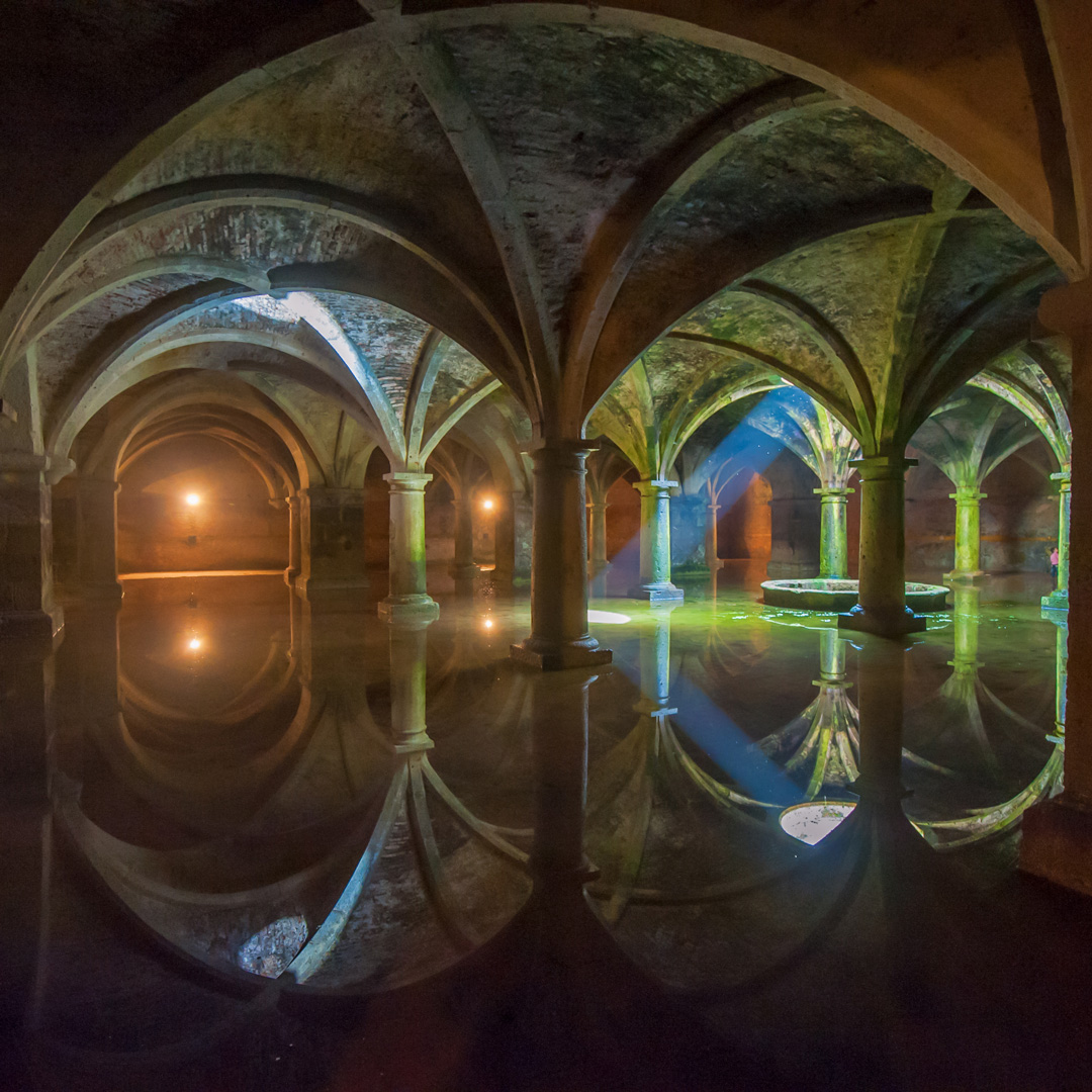 Portguese architecture reflected in the water of a cistern in Morocco