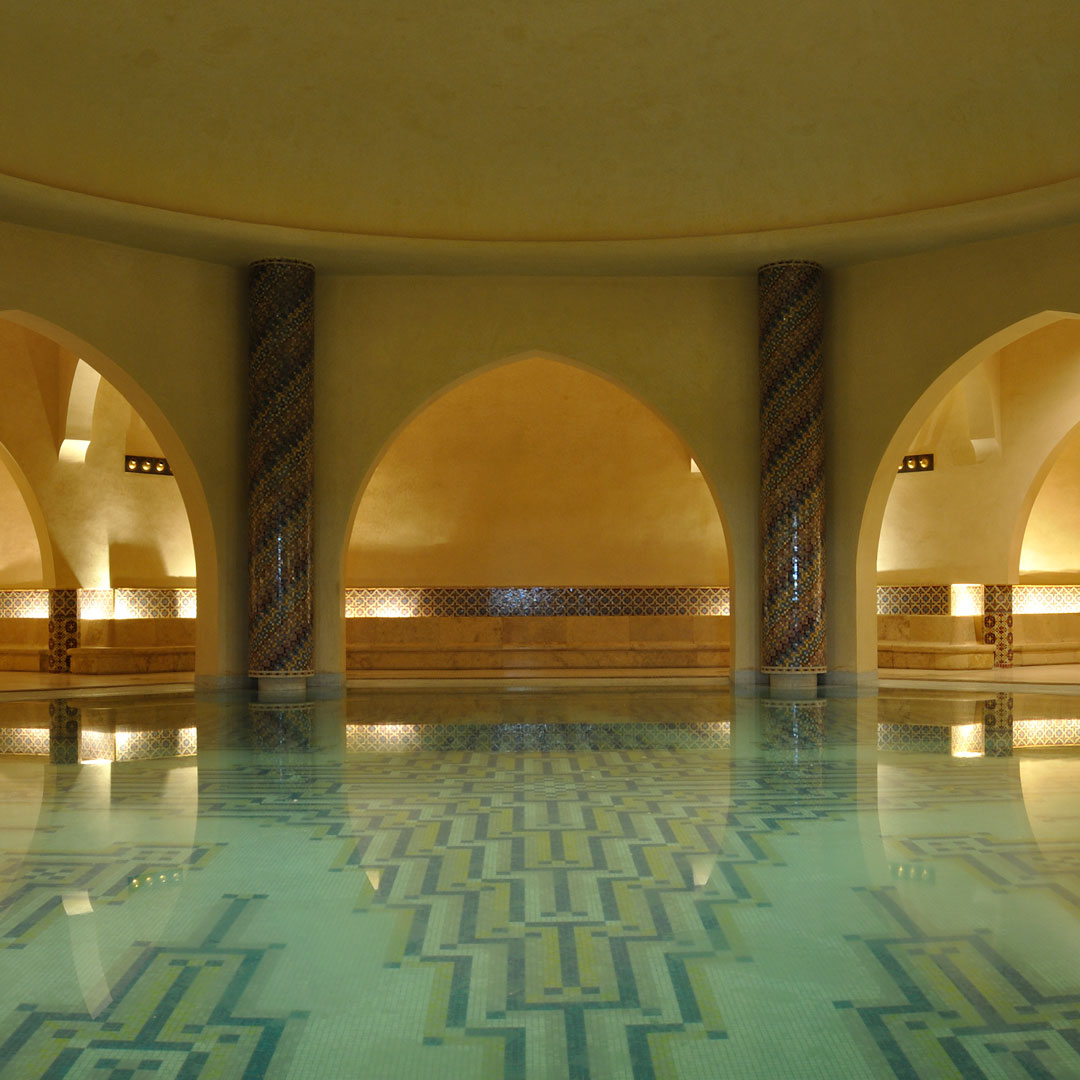 lowlit pool in a traditional Moroccan bath (or hammam)