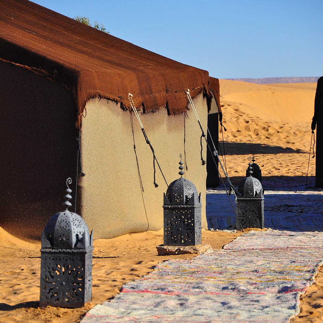 lamps lining a path to a tent in the Sahara Desert, Morocco