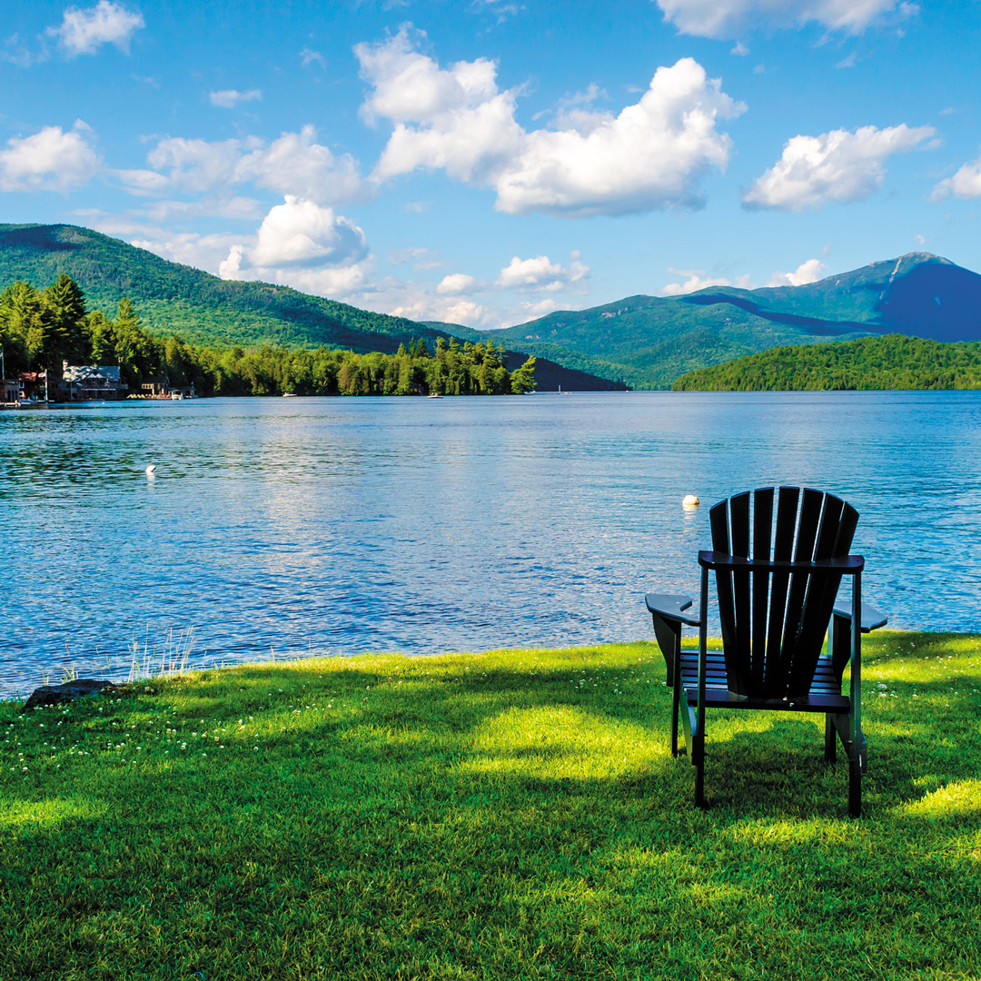 adirondack chair sitting on the shores of Lake Placid