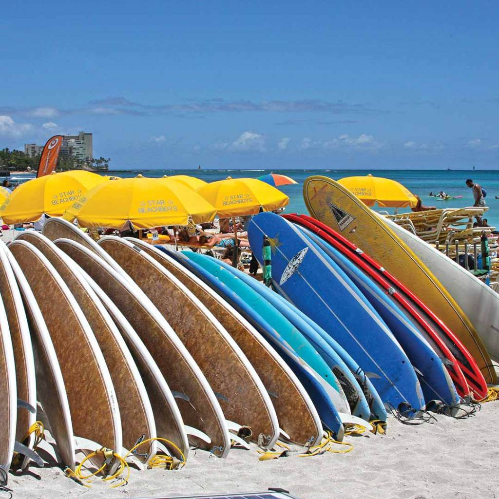 Surfboards on Waikiki Beach. Photo © Kevin Whitton.