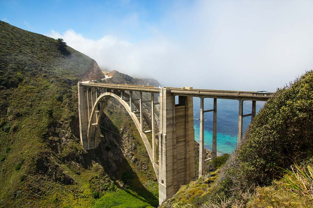 coastal fog wafting toward the bixby bridge