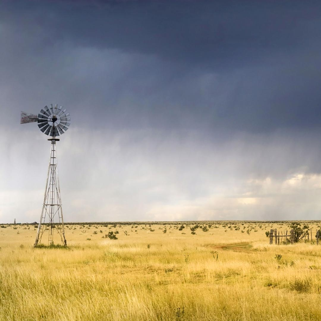 cloudy skies over a windmill and plains in the Texas Panhandle