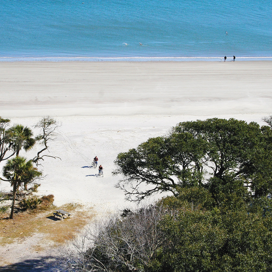 cyclists on the beach in South Carolina's Hunting Island