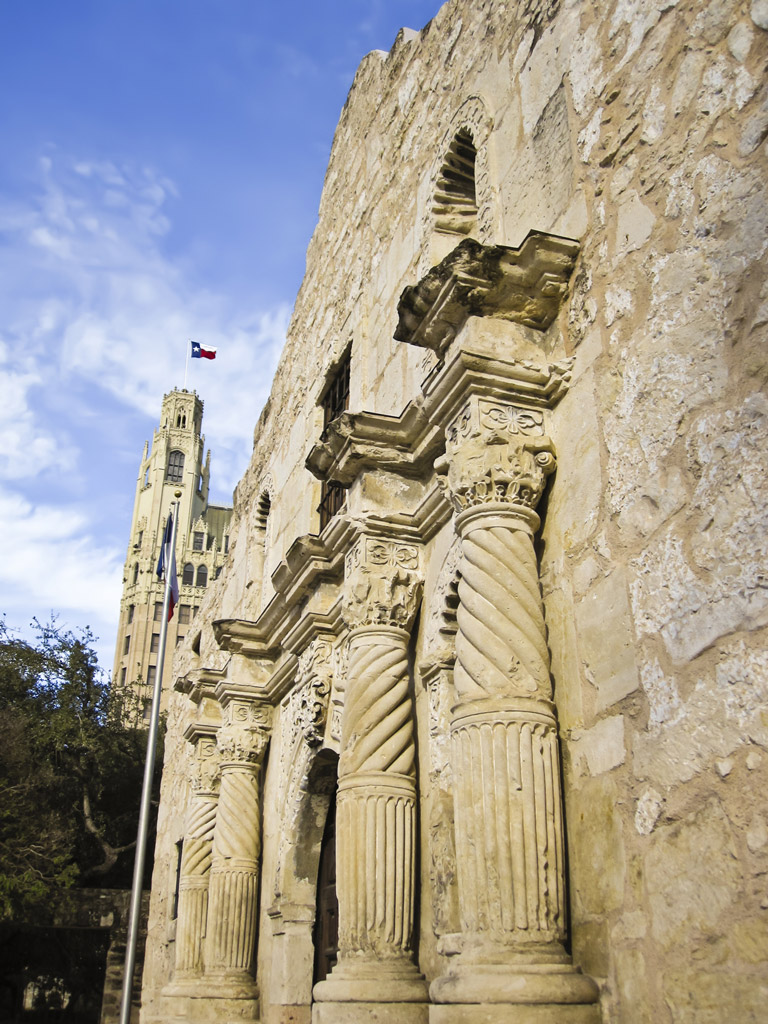 view of the front facade of the Alamo with blue sky above it